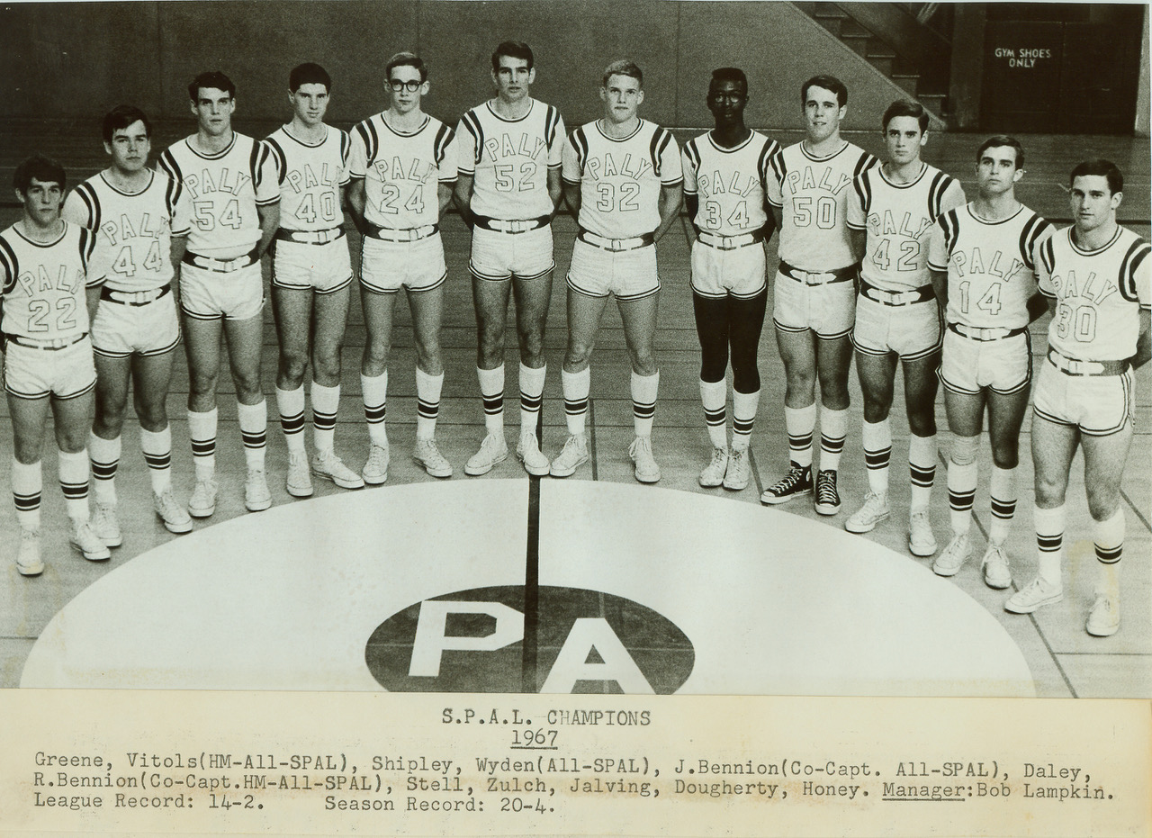 The 1967 Santa Clara Valley Athletic League championship basketball team at Paly poses for a group photo on the court. Photo courtesy of the Palo Alto Historical Association.