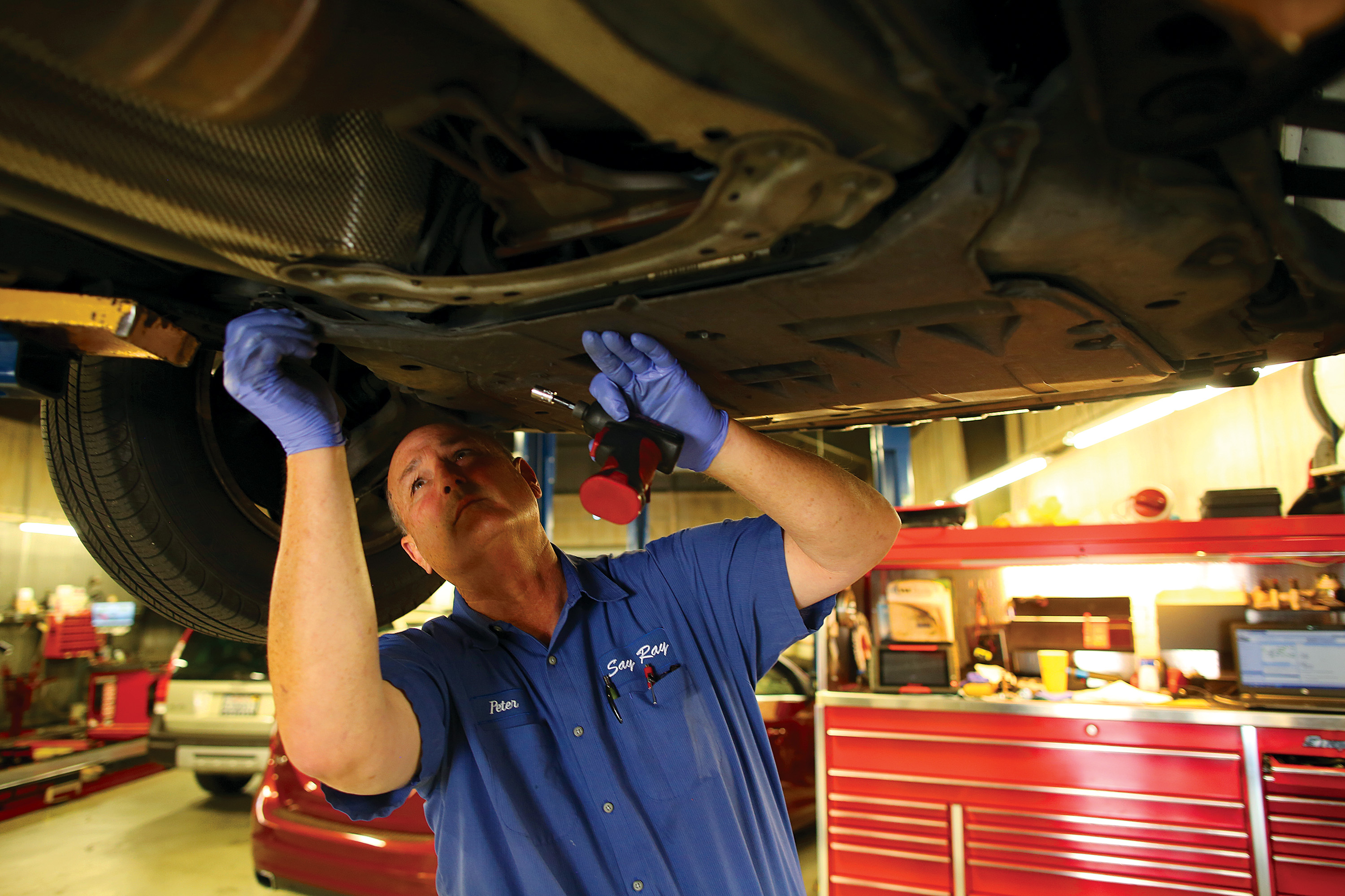 Peter Longanecker, owner of autmotive repair shop Say Ray, works on a Volvo on Oct. 1. Photo by Sammy Dallal.