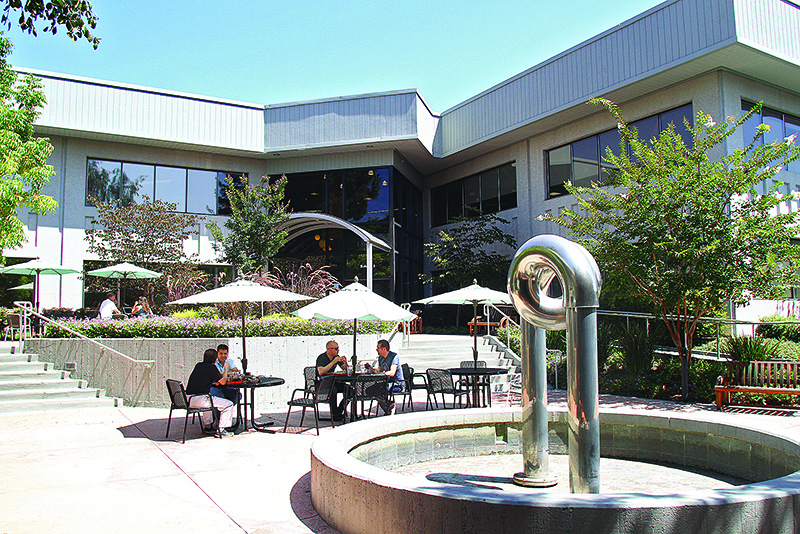 Employees at SAPin the Stanford Research Park dine outsideduring lunch in 2015.