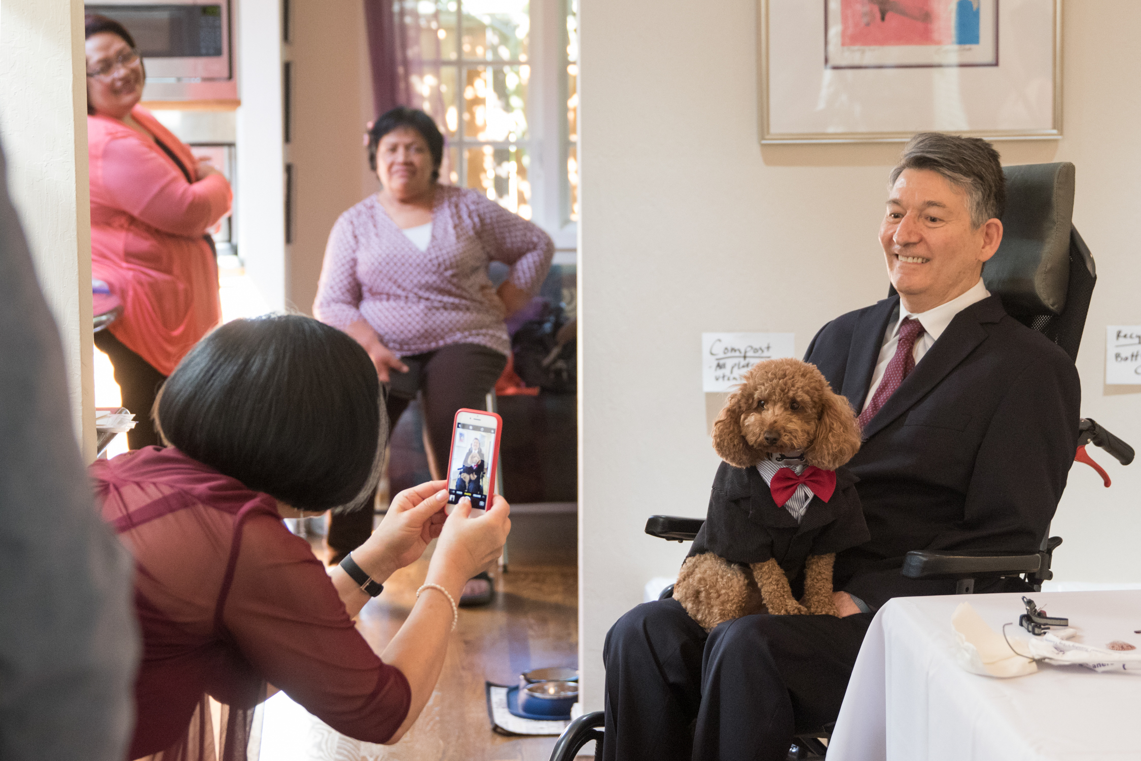 Karen Kang takes a photo of Jon Ferraiolo with their dog, Pepe at their home on April 14, 2018.