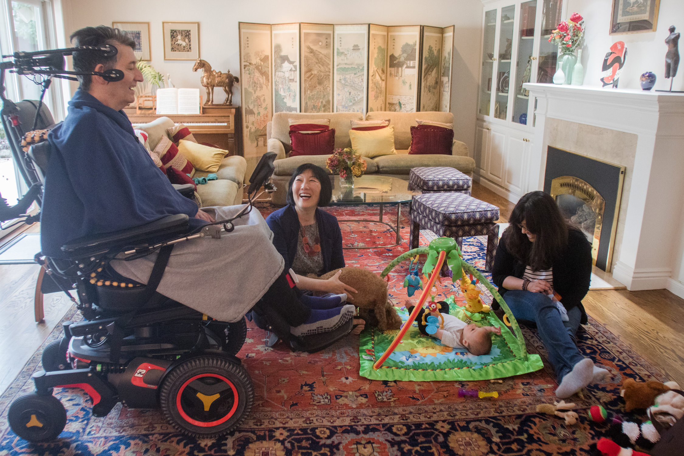 Jon Ferraiolo spends time with his daughter, Nikki Ferraiolo, and grandson, Theo, alongside his wife, Karen Kang, at their home on March 13, 2018. Nikki Ferraiolo, who lives in Washington, D.C., flies out to visit her parents about once a month.