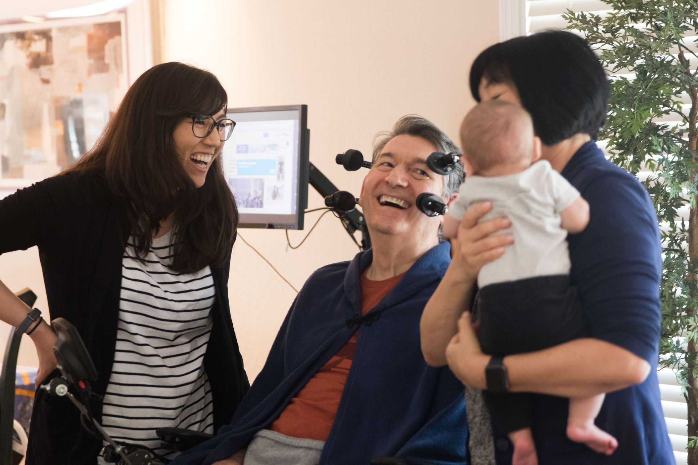 Jon Ferraiolo and wife Karen Kang laugh with their daughter Nikki Ferraiolo as they spend time with their grandson, Theo, on March 13, 2018.