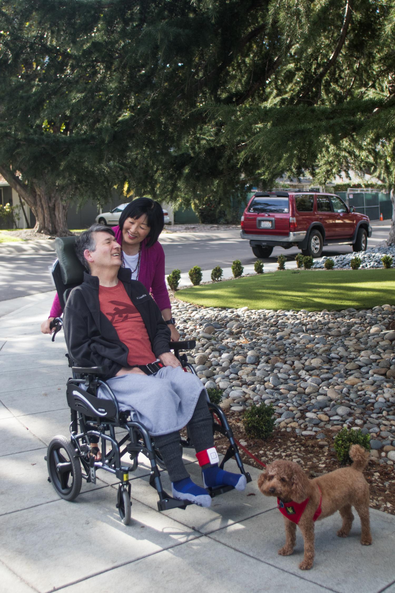 Karen Kang and Jon Ferraiolo go for a stroll around their Duveneck/St. Francis neighborhood with their dog, Pepe, on March 8, 2018.