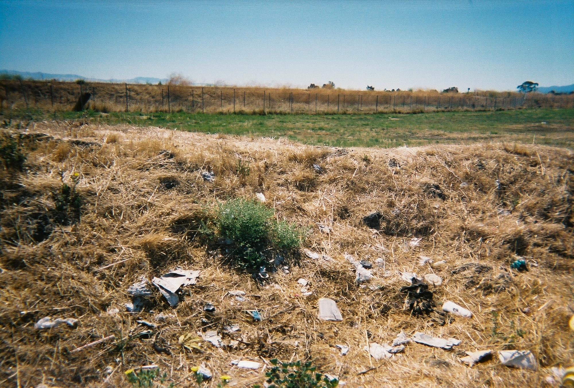 Trash and debris litter an open field in East Palo Alto. (Photo courtesy ofNathalia Arias.)