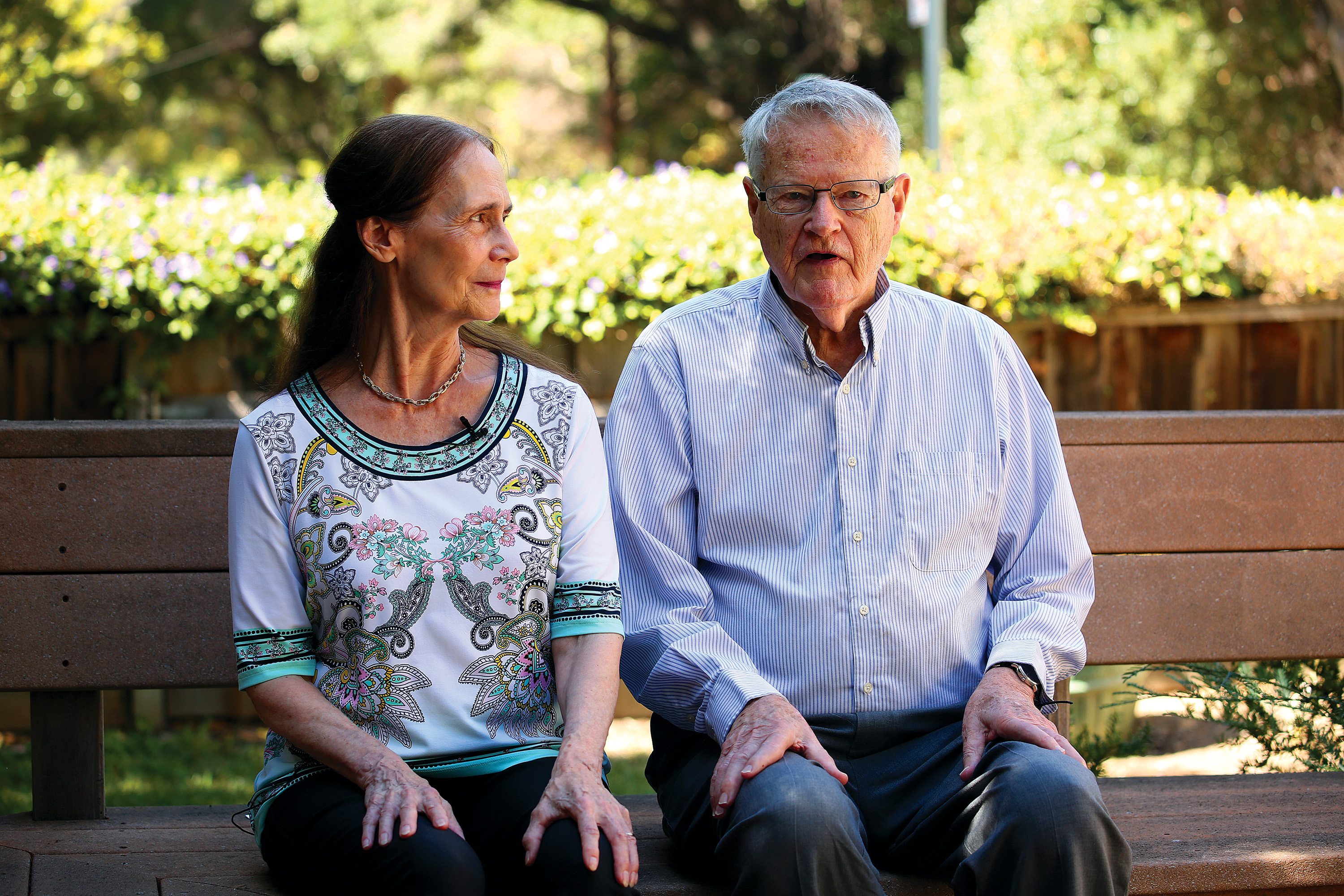 April Eiler and Palmer Pinney, longtime residents of Poe Street in Palo Alto, say that their neighborhood is not as cohesive as it once was, as new homeowners and renters have moved in. Photo by Sammy Dallal.