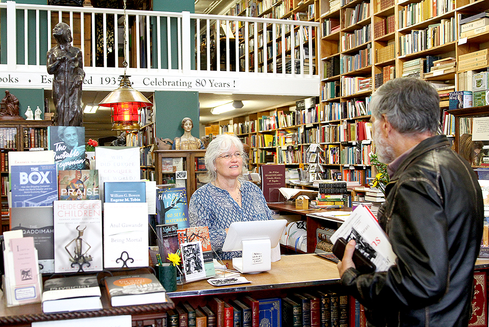 Faith Bell, owner of Bell's Books, talks with a longtime customer on Sept. 30, 2015 as the bookseller prepares for its 80th anniversary party. File photo by Veronica Weber.