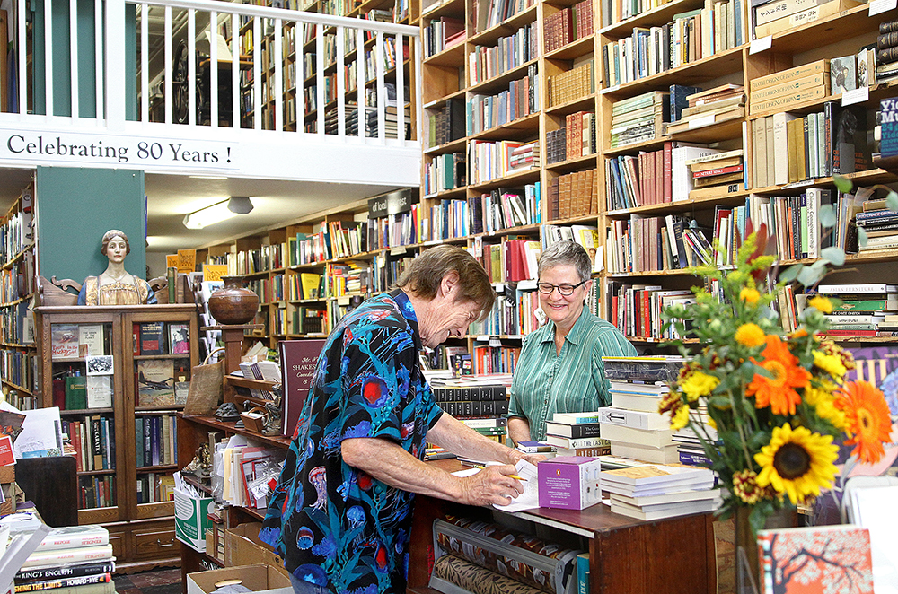 Booksellers Tärna Rosendahl and Christopher Storer check in new inventory at Bell's Books on Sept. 30, 2015. File photo by Veronica Weber.