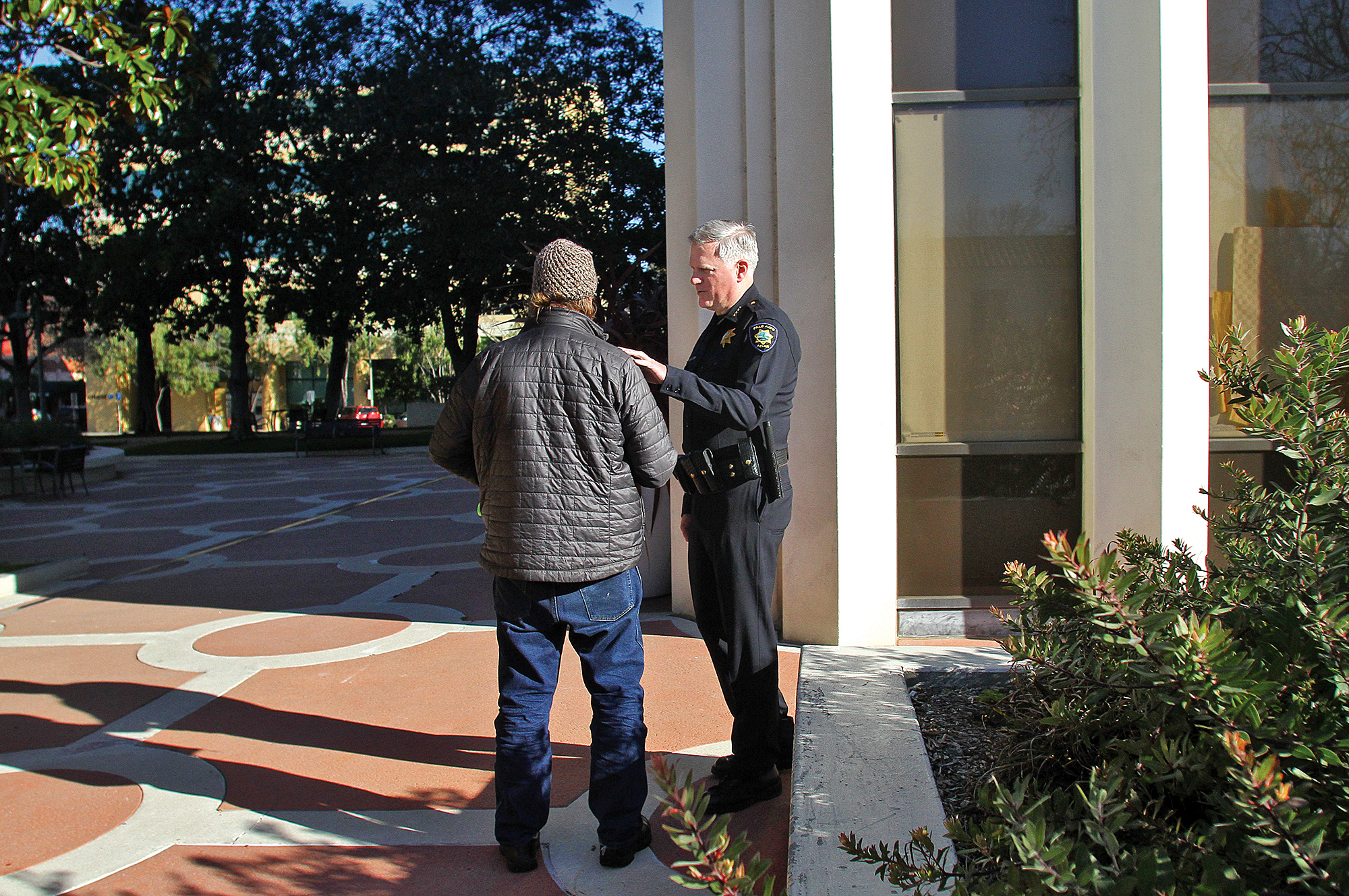 Chief Dennis Burns greets a man outside of City Hall on Dec. 29, 2016.