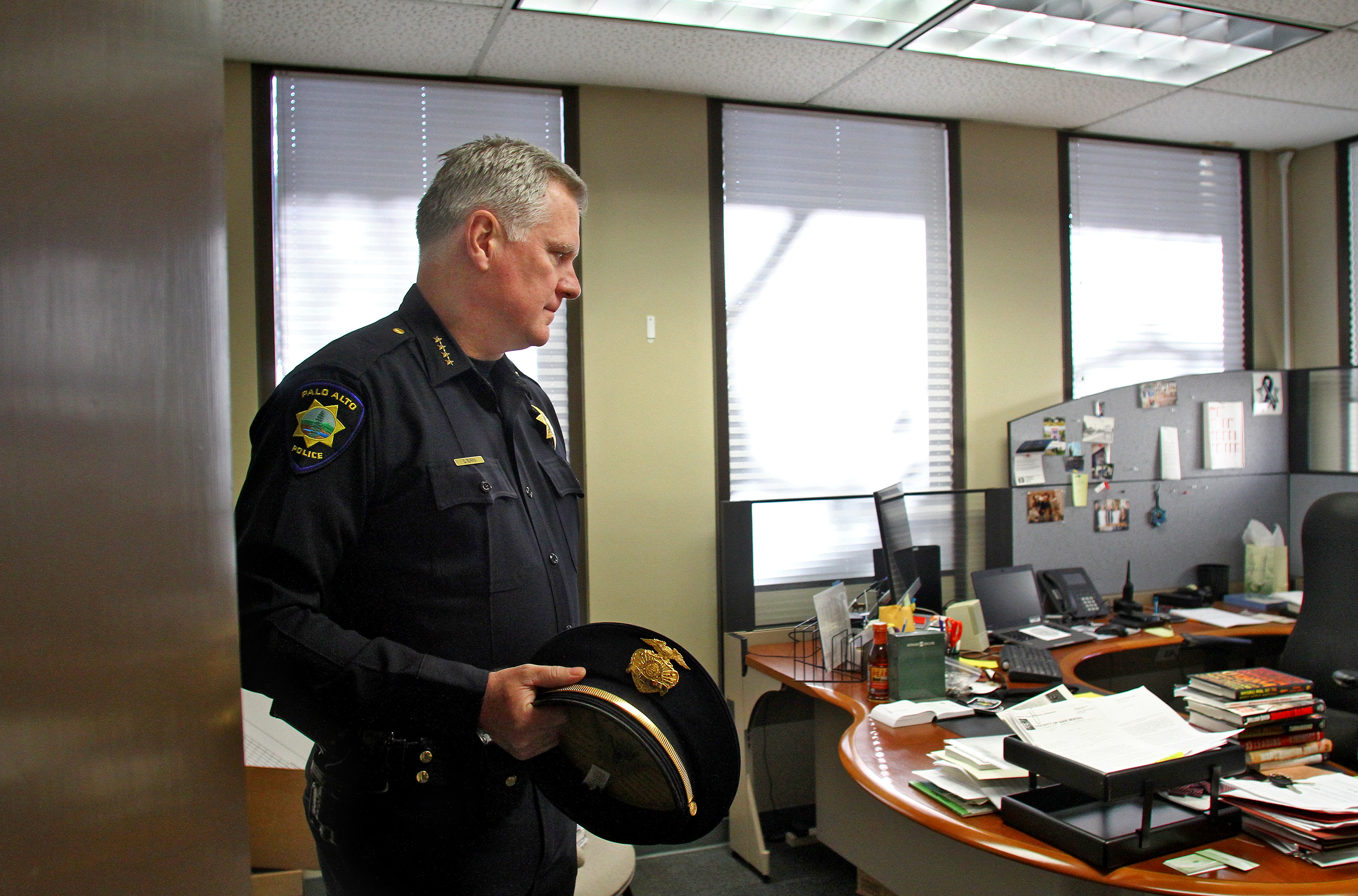 Palo Alto Police Chief Dennis Burns stands on Dec. 29 in his office at City Hall on his last day of workbeforeretiring. Photo by Veronica Weber/Palo Alto Weekly.