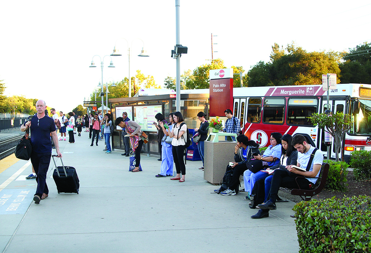 Commuters wait for the train at the University Avenue station in downtown Palo Alto, where the Stanford Marguerite shuttles and VTA buses wait to take commuters to their jobs.