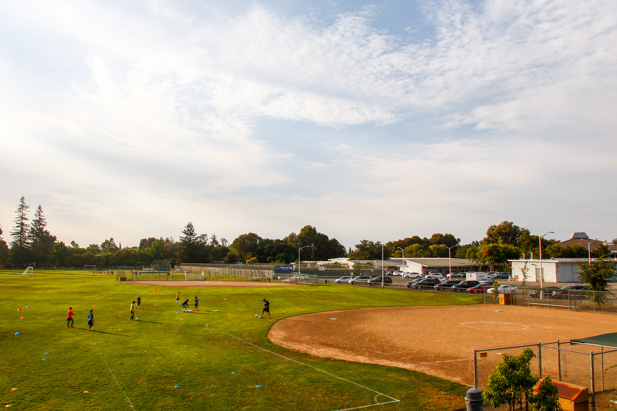 Players from the Palo Alto Soccer Club do drills at the soccer fields behind the main buildings at the Cubberley center, which has tennis courts, softball fields, soccer fields, a football field and running track.