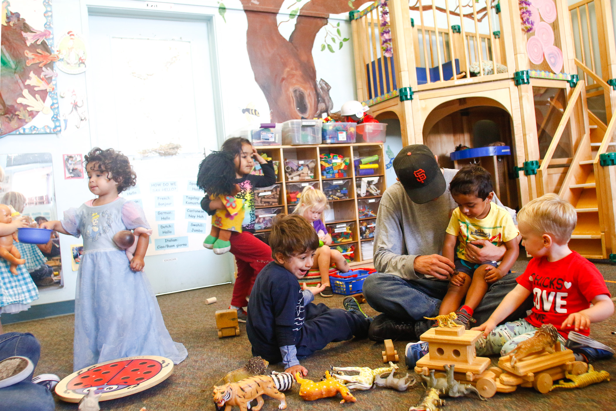 """Preschoolers, from left, Olivia, Mahika, Manu, Randeep and Michael play in the """"Robins"""" room with their teacher Chris Brummett, third from right, and Zenobah Williams-Roberson (not pictured) at the Children's Preschool Center."""