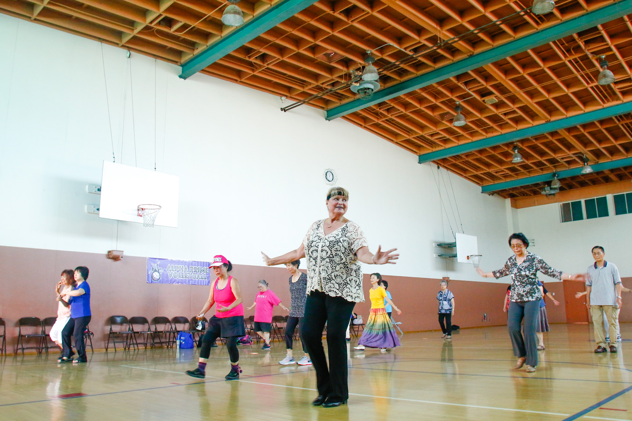 Lori Rock, center, leads line dancing lessons to seniors during Senior Friendship Day - a free,weekly senior-focused program that offersclasses as well as lectures and social activities. Line dancing and lunch provided by La Comida.