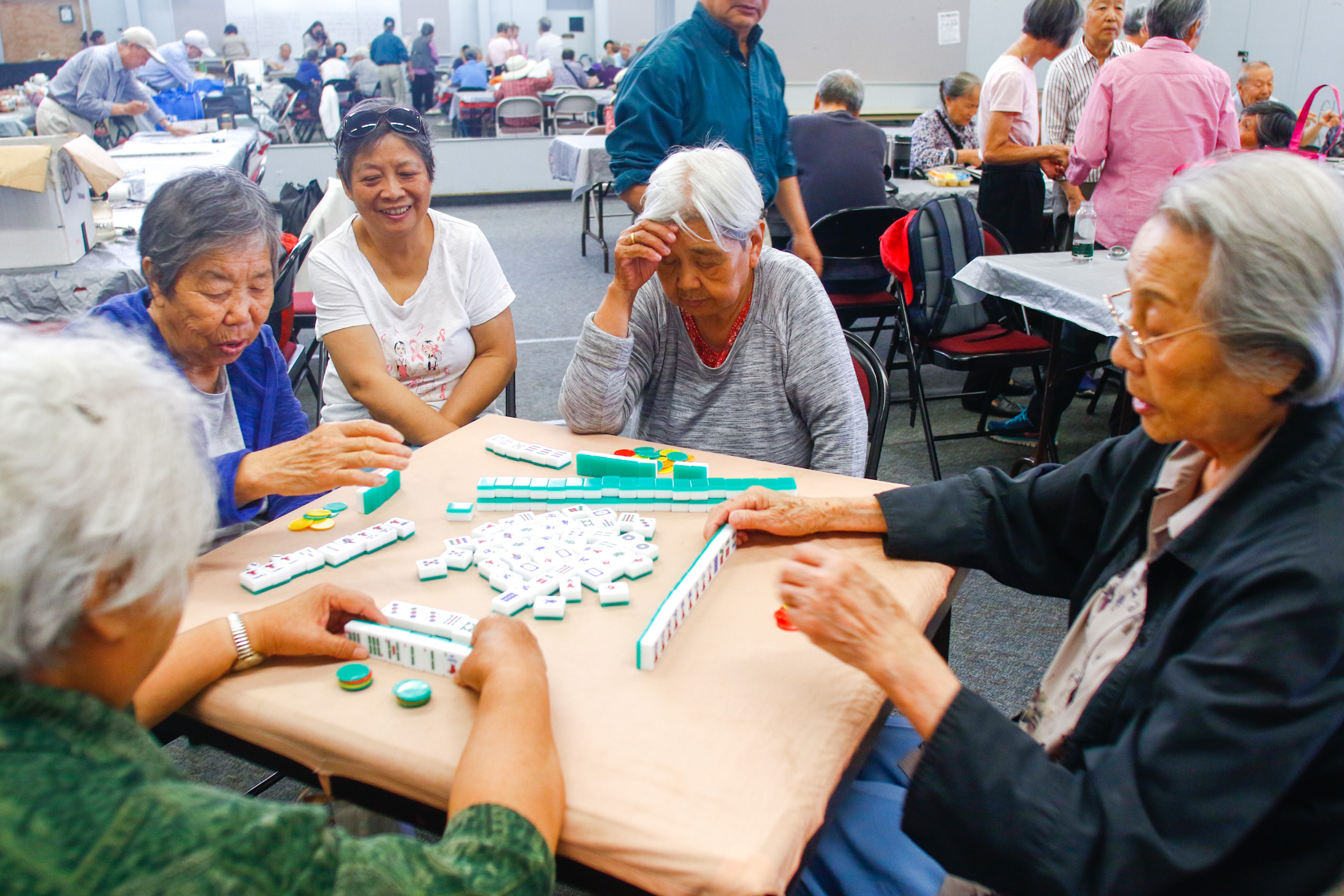 Participants of Senior Friendship Day play a game of mahjong in room M-4.The program has been offered at Cubberley for 23 years, serving about 150 seniors.