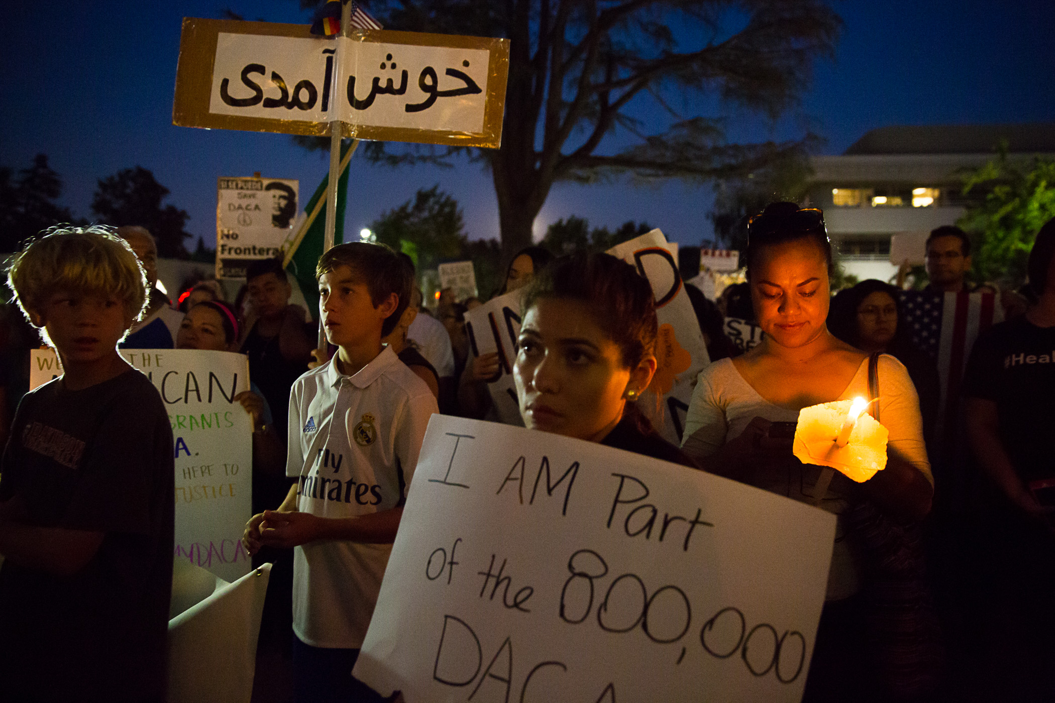 A crowd gathers at the Mountain View Civic Center for a candlelight vigil in support of the Deferred Action for Childhood Arrivals program on Sept. 5, 2017. Photo by Michelle Le.