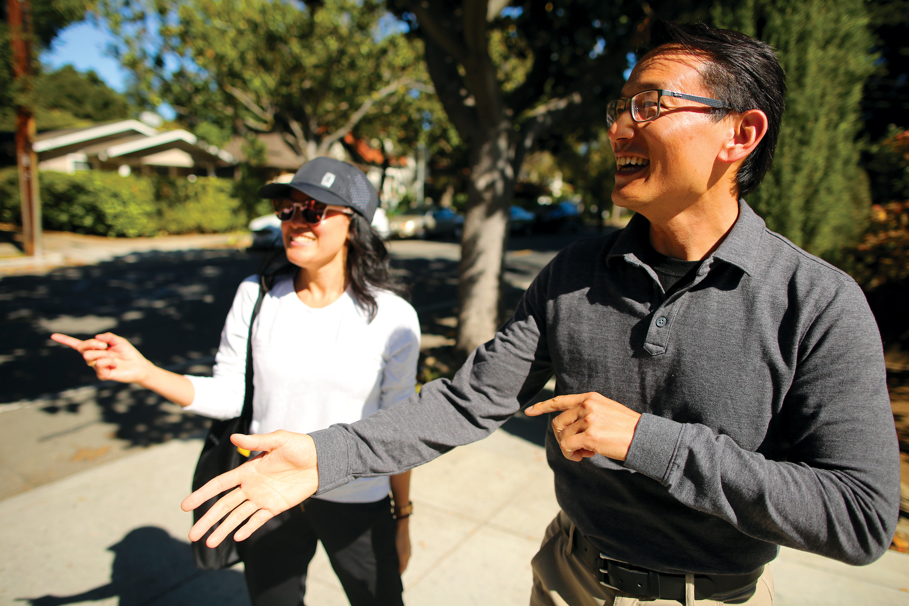 David Shen, a resident of Churchill Avenue, right, speaks with Irene Au outside of his home on Oct. 2. Photo by Sammy Dallal.