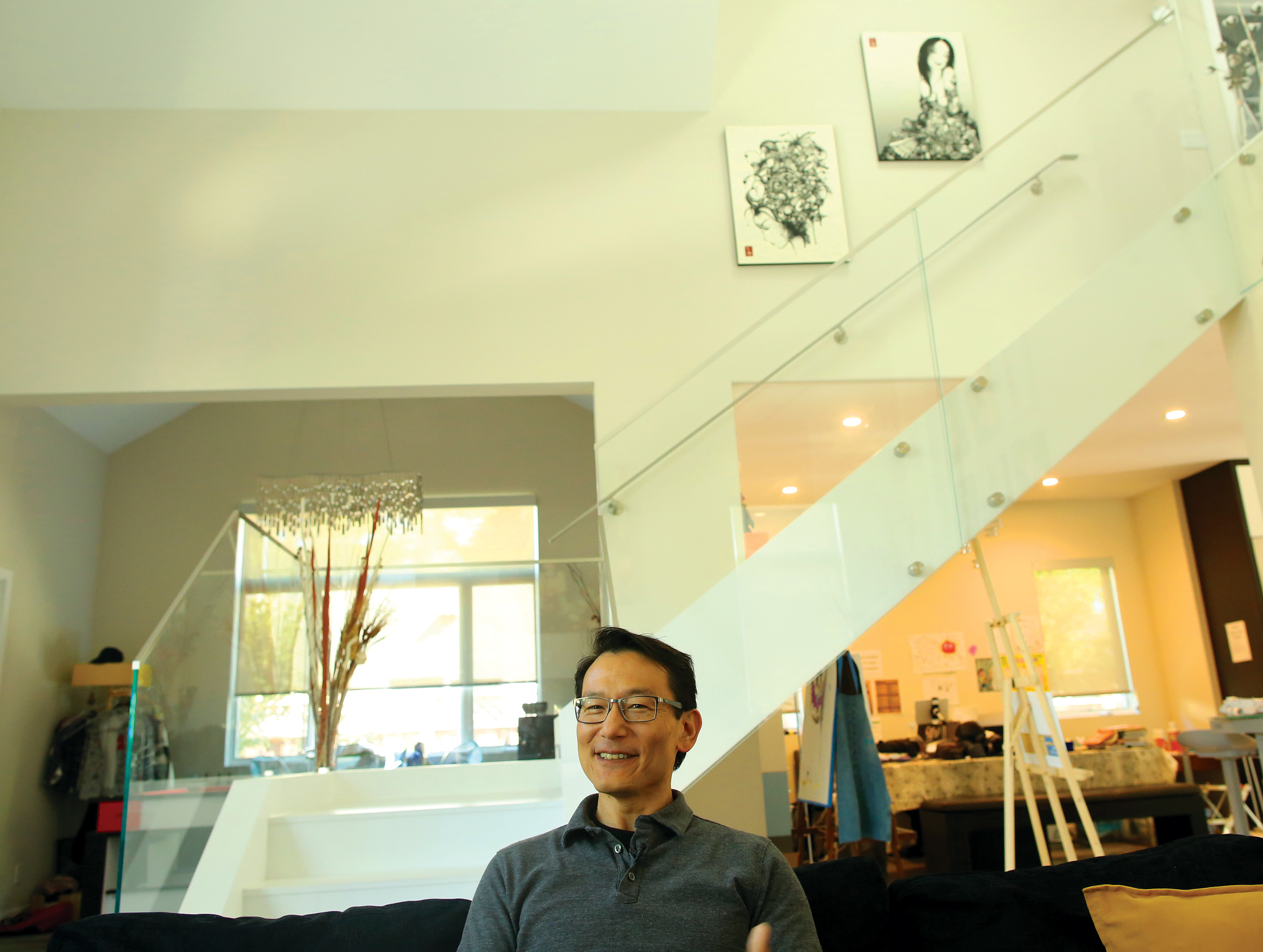 David Shen, a resident of Churchill Avenue in Palo Alto, talks about his neighborhood, where residents have banded together to fight a possible taking of their properties as part of the construction of a new rail crossing. Photo by Sammy Dallal.