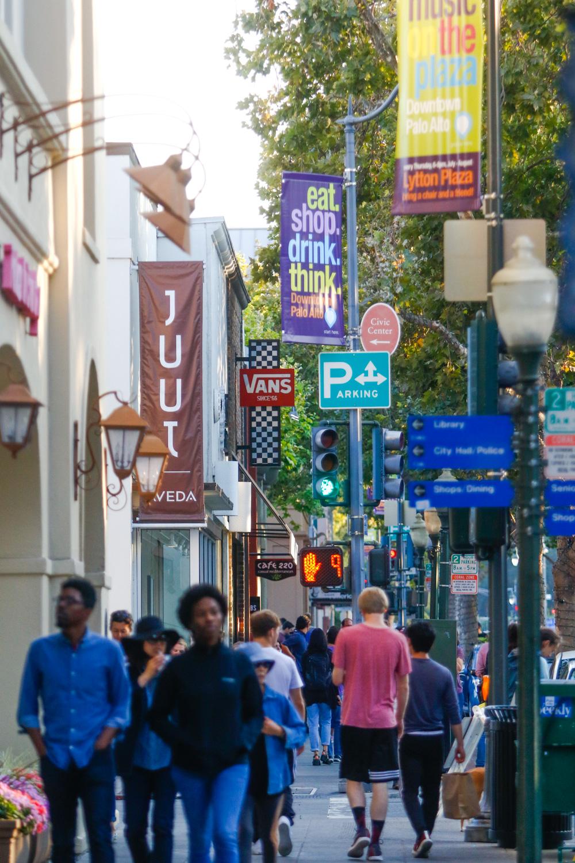 People stroll along University Avenue in downtown Palo Alto. File photo by Veronica Weber.