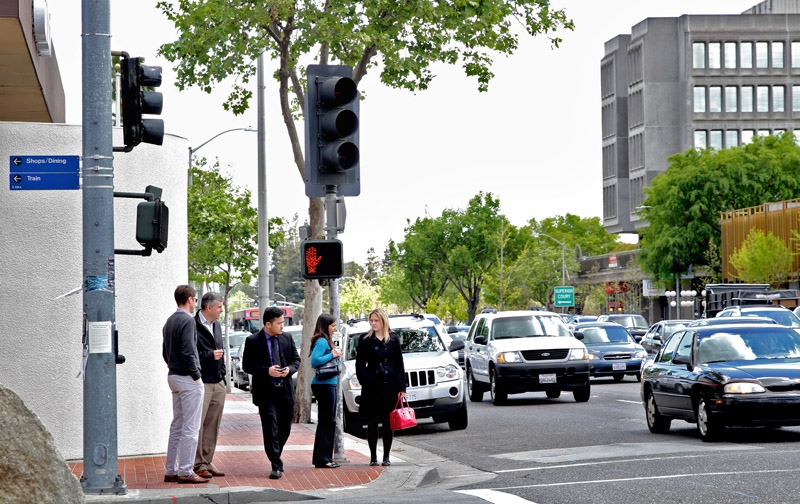 Cars zip past the corner of El Camino Real and California Avenue in Palo Alto. The Santa Clara Valley Transportation Authority is planning on debuting Bus Rapid Transit, which would create curbside boarding platforms to speed up bus service along the major thoroughfare.