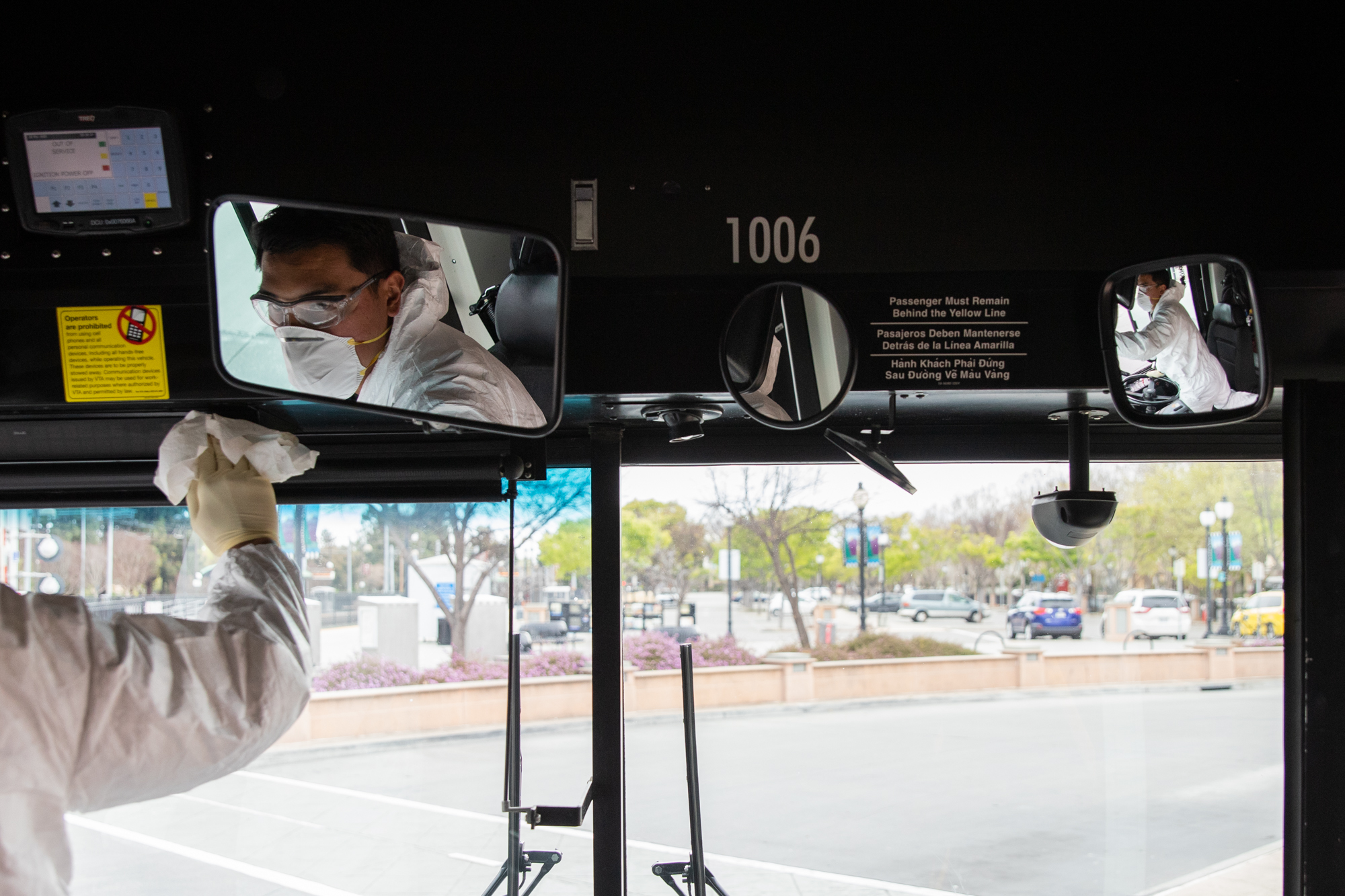 A VTA worker cleans the driver's seat on a bus at the Mountain View train station on March 18. Photo by Magali Gauthier.