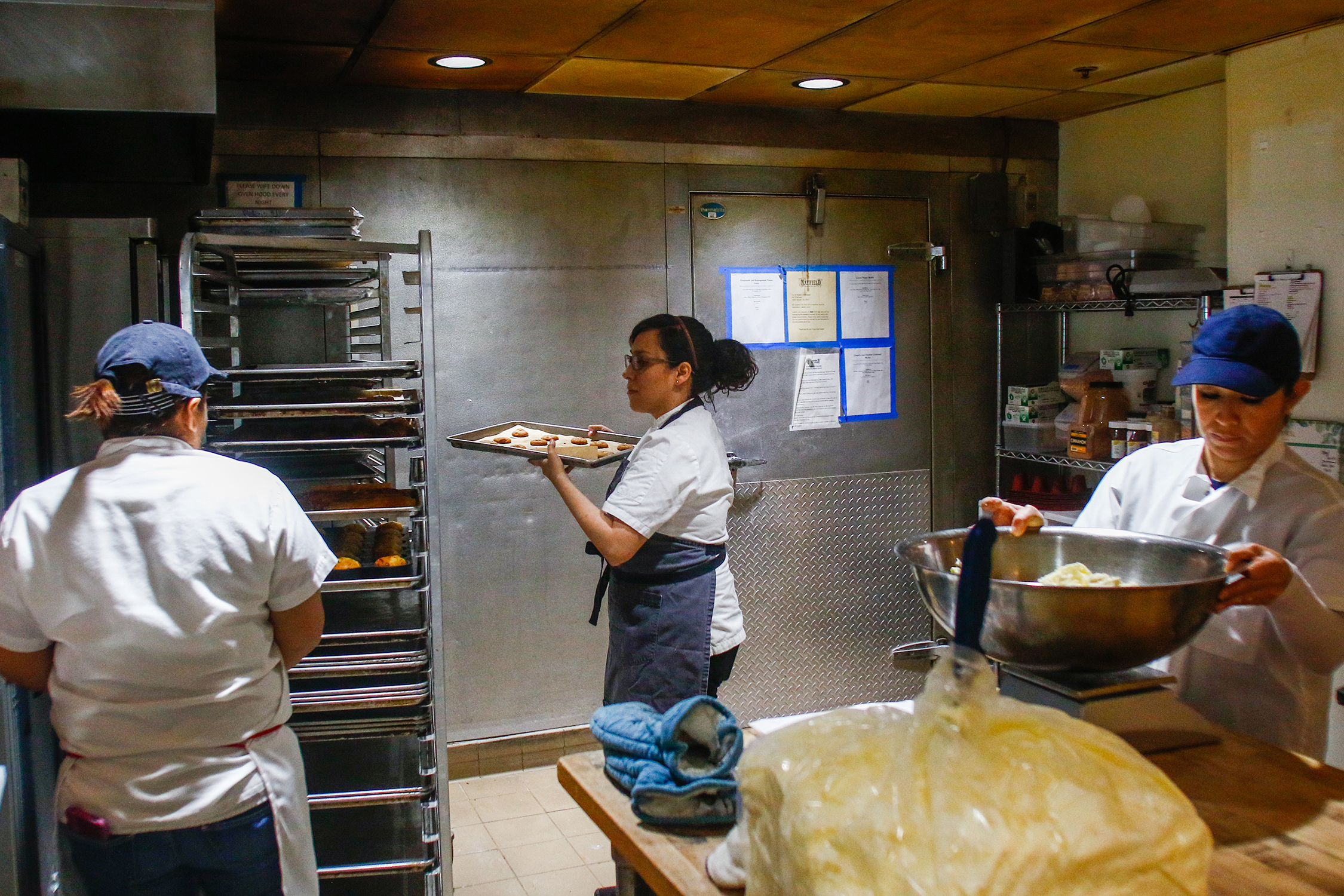 Janina O'Leary works in the kitchen atMayfield Bakery & Cafe. Photo by Veronica Weber.