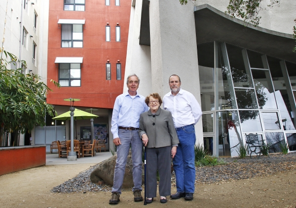 From left, Don Barr, Litsie Indergand and John Barton of the Community Working Group stand in front of the Opportunity Center in Palo Alto. They spearheaded the $25 million development, which opened in 2006.