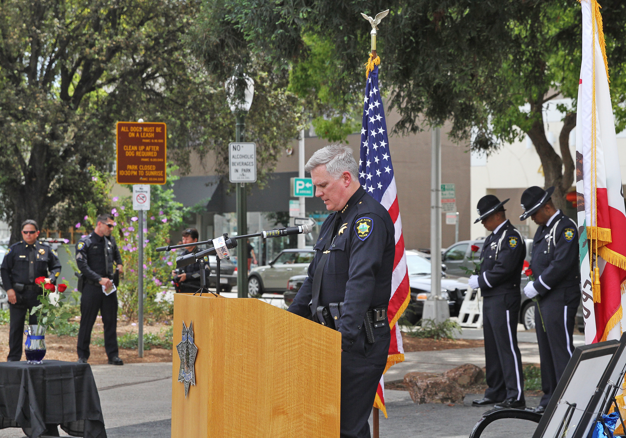 Among his duties as Palo Alto's top cop,Chief Dennis Burns addresses the crowd gathered for a memorial tribute for Palo Alto's three fallen officers and the installation of the Palo Alto Police Officers Memorial Grove on May 15, 2014, at Cogswell Plaza in downtown.  Photo by Veronica Weber/Palo Alto Weekly.