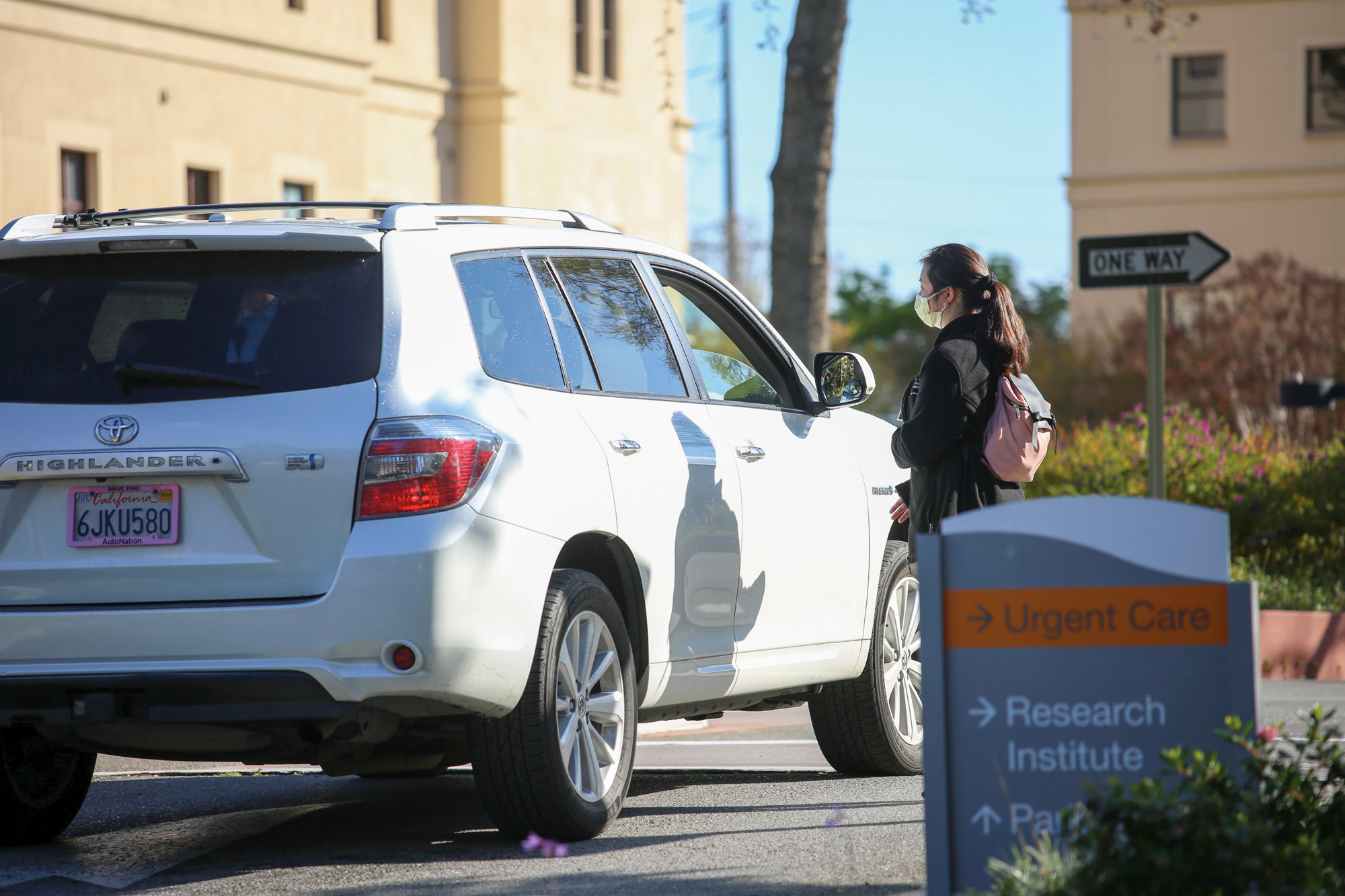 Sutter Health employees direct traffic at their facility in Palo Alto on March 19. Photo by Sammy Dallal.