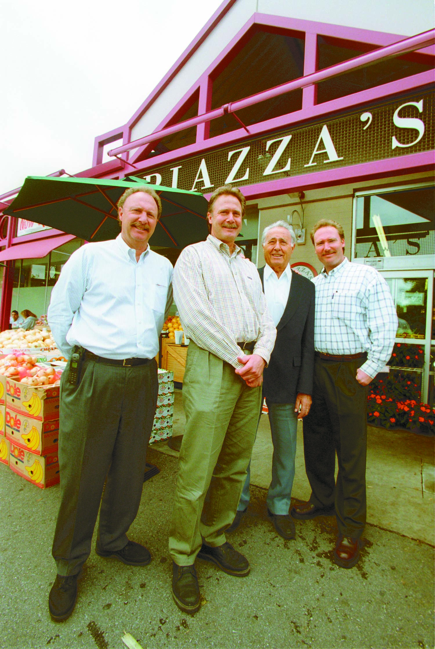 John Piazza Jr., Gary Piazza, John Piazza Sr. and Rick Piazza pose outside of their grocery store in Palo Alto. The family previously opened a grocery store in Park Merced neighborhood in San Francisco.Weekly file photo.