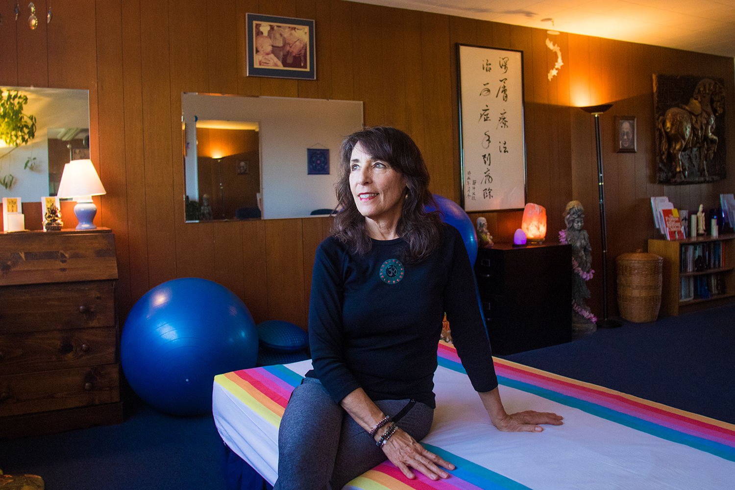 Karen Price sits in her studio on Cambridge Avenue in Palo Alto, where she operates her private practice as a certified rolfer. Price says that being self-employed and able to afford her office studio for 39 years defines what it means to be middle class in the city.