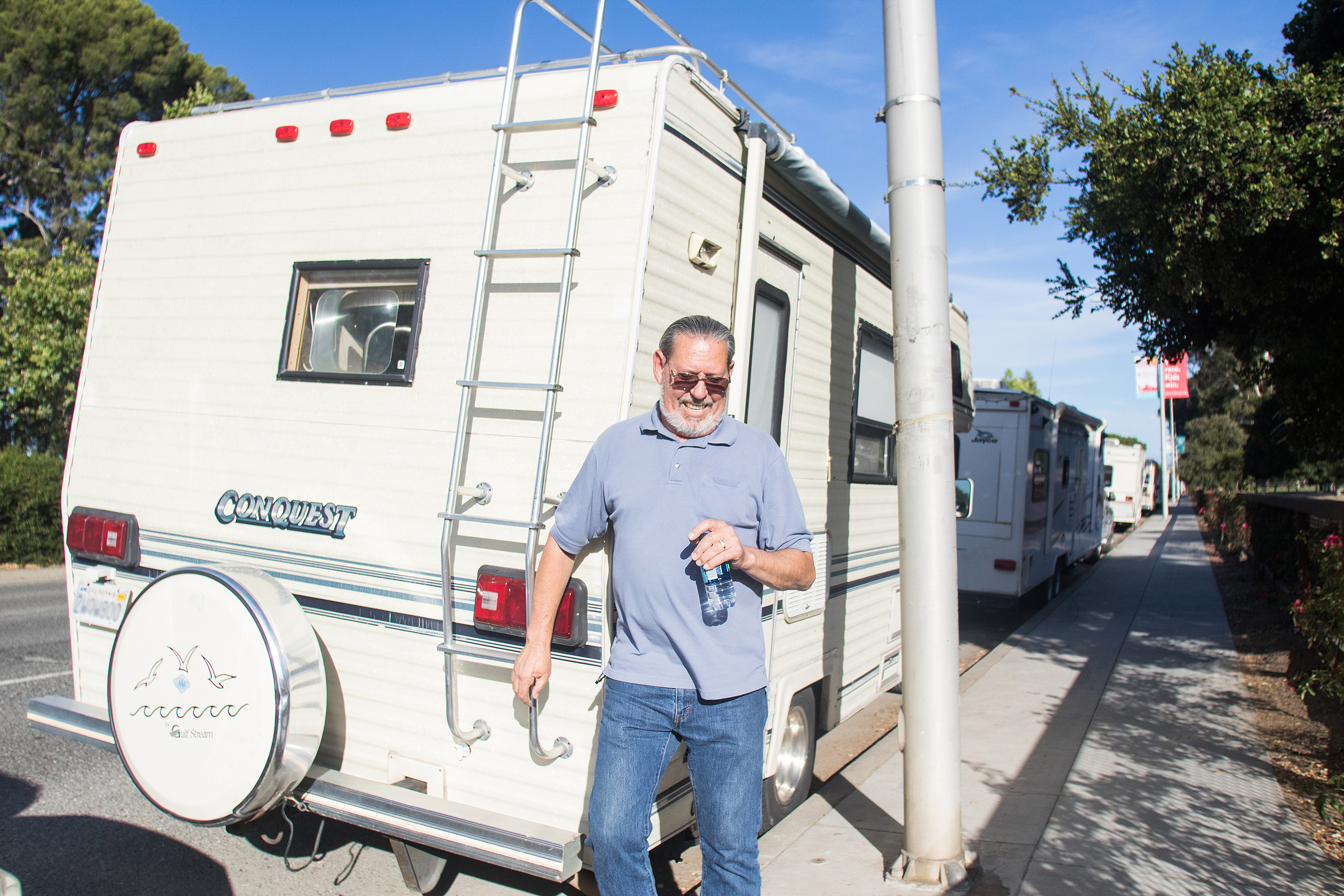 Ray gets ready to head into his RV parked on El Camino Real after working at his full-time job in mechanical operations, a position he's held for over 29 years.