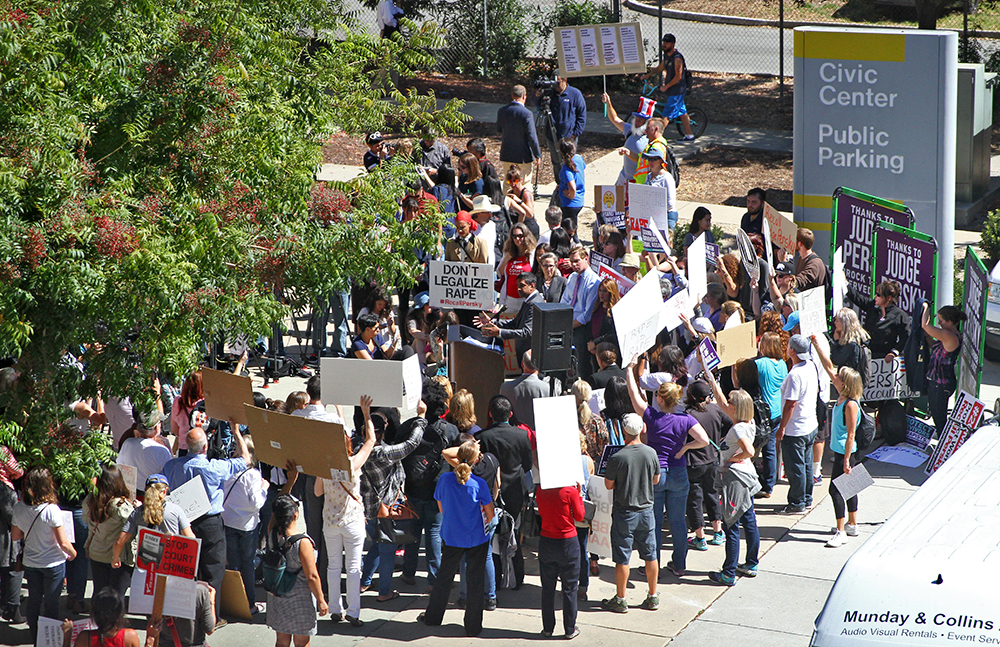 Crowds gather across the street from the Santa Clara County Main Jail in San Jose to speak out against Superior Court Judge Aaron Persky, who sentenced former Stanford University student Brock Turner to six months in jail for sexual assault.Photo by Veronica Weber.
