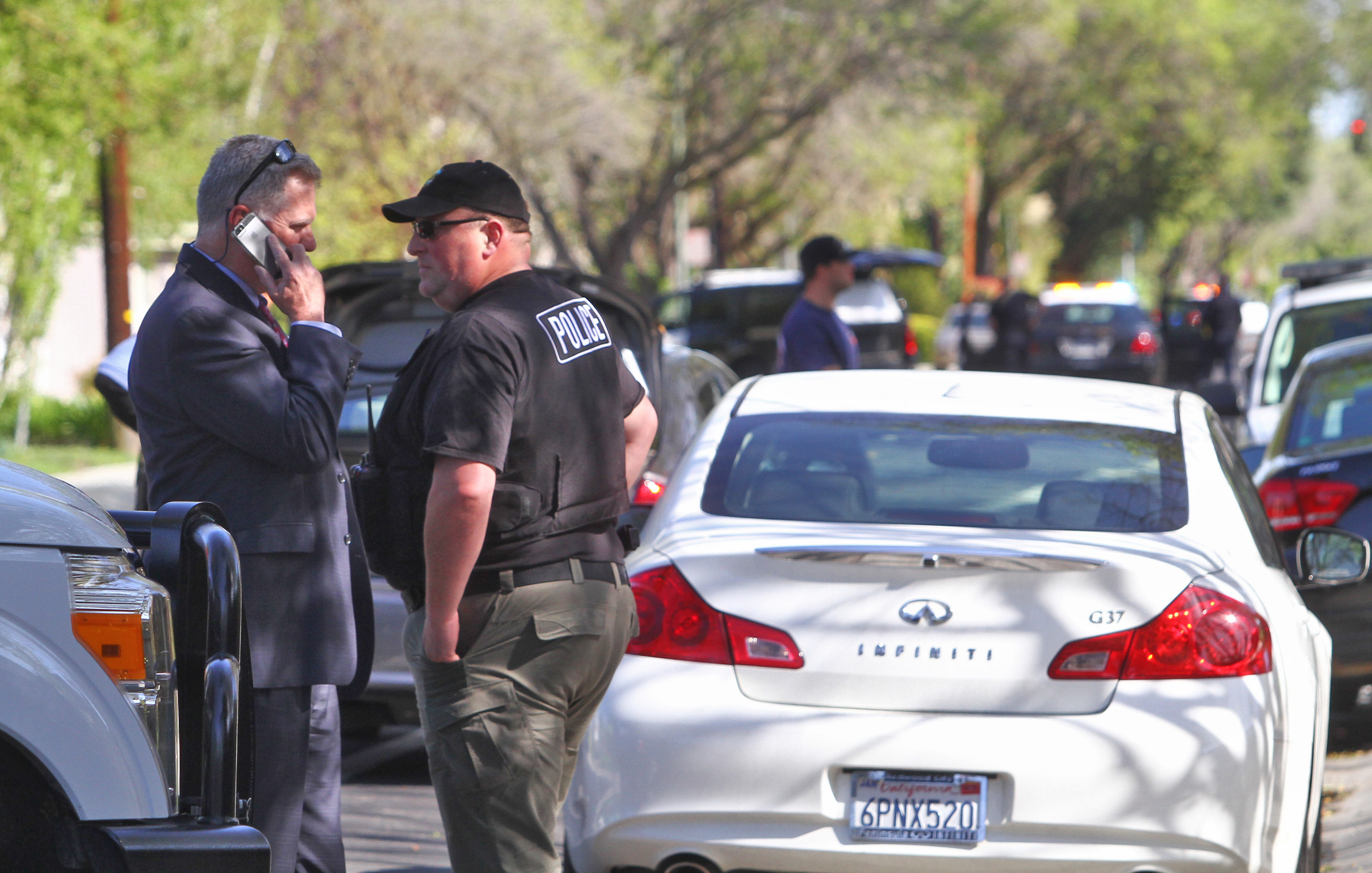 Palo Alto Police Chief Dennis Burns, left, talks with Director of Emergency Services Ken Duekerabout a suspect who has barricaded himself inside a residence on Elsinore Drive on March 23, 2015.  Both the negotiators and SWAT team were used to extract the man, who was takeninto custody.  Photo by Veronica Weber/Palo Alto Weekly.