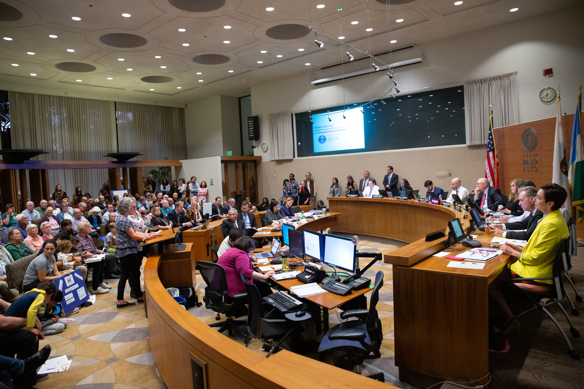 Local elected leaders address the Santa Clara County Board of Supervisors during a hearing on Stanford University's expansion plan at Palo Alto City Hall on Oct. 22. Photo by Magali Gauthier.