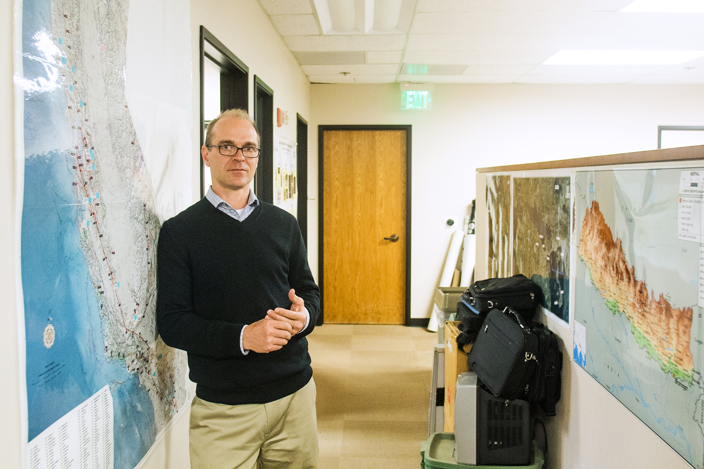 Dan Coughlin, director of Quake Finder, stands next to a map of California showing the locations of some of the company's 170 earthquake sensors which measure electromagnetic changes.