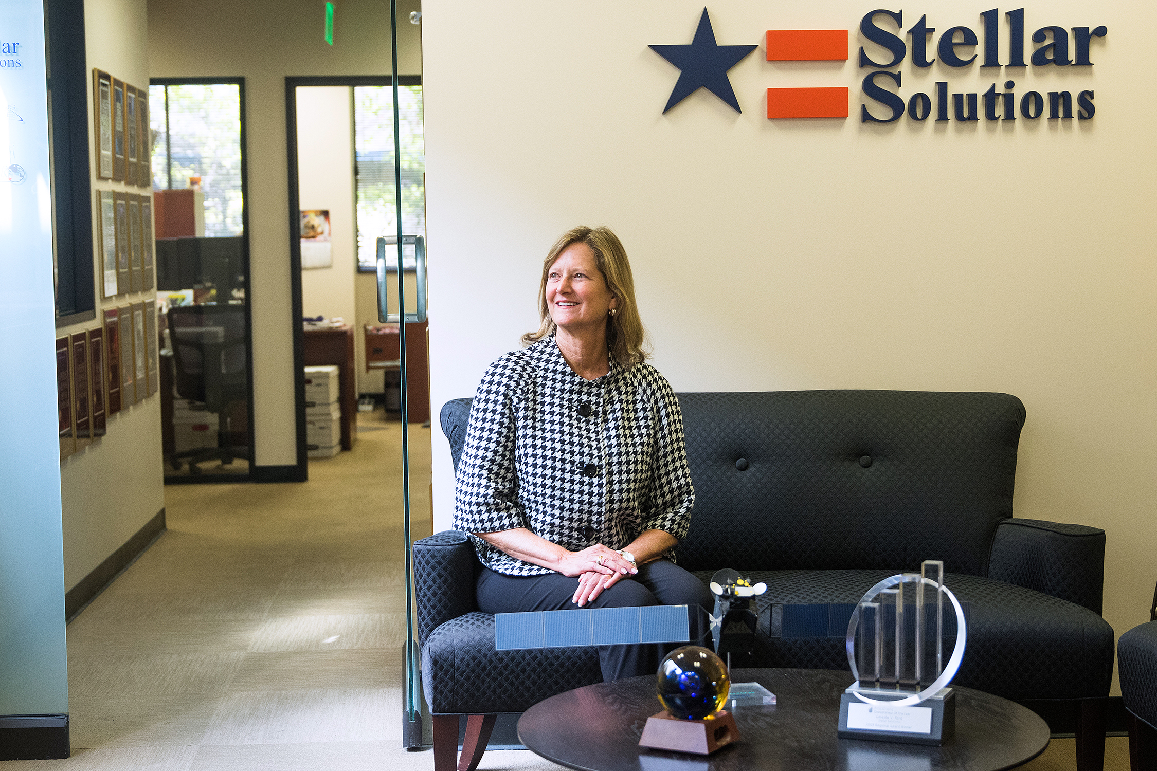 Celeste Ford, founder and CEO of Stellar Solutions, sits in the Palo Alto company's lobby on March 7, 2018. Stellar Solutions provides engineering consulting in the aerospace industry.