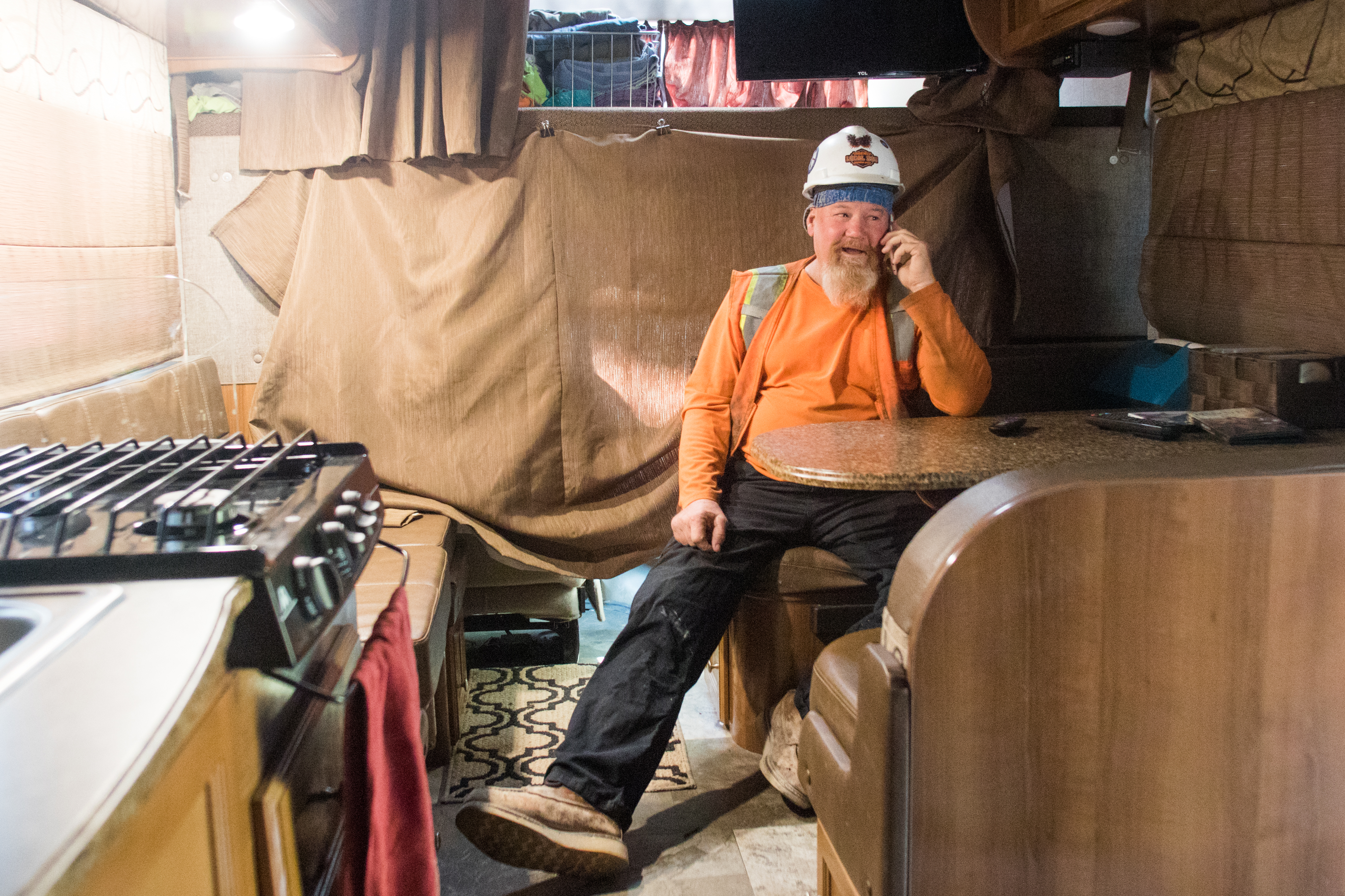 Journeyman plumber Todd Boyd talks on the phone to setup his morning ride to work.