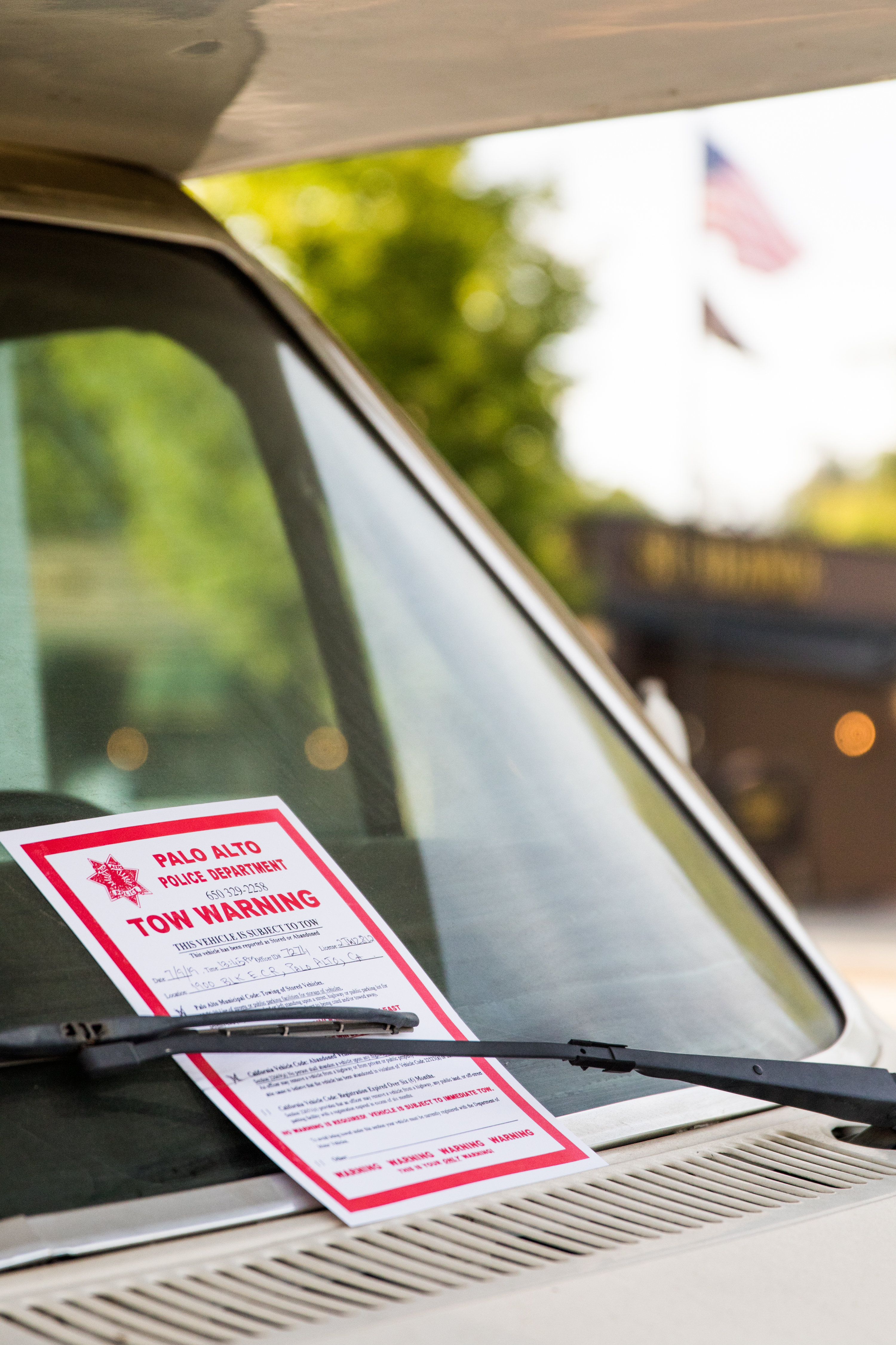 A tow warning notice is left on an RV'swindshield parked on El Camino Real. Every few weeks, RV owners say Palo Alto police leave the 72-hour notices on vehicles that must be moved at least half a mile away.